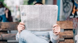 man reading news paper about ERP software