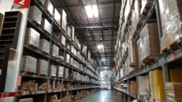 View of an aisle in a warehouse full of boxes